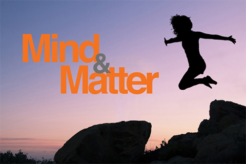 Image of a person leaping from one stone to another with the Mind and  Matter logo to one side