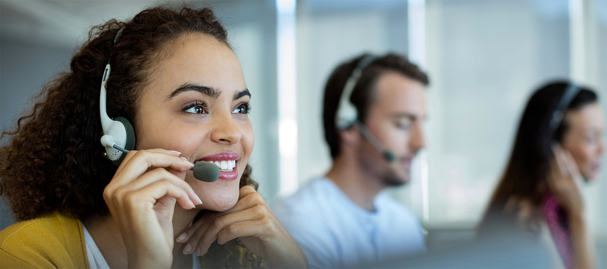 Image of woman answering the telephone in a call center