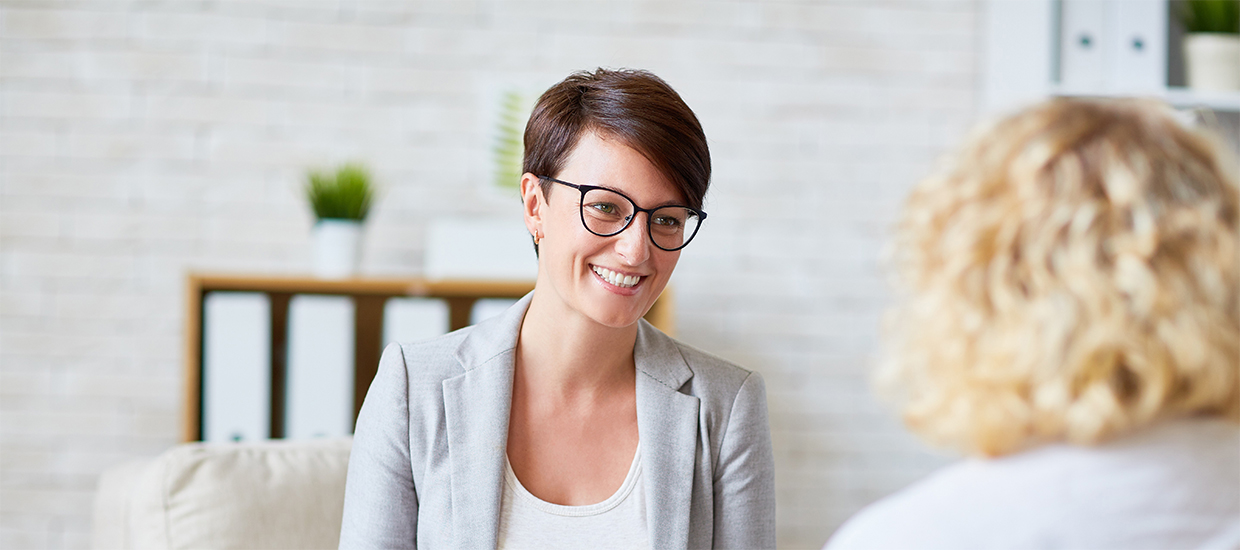 Image of a woman receiving a workplace consultation session